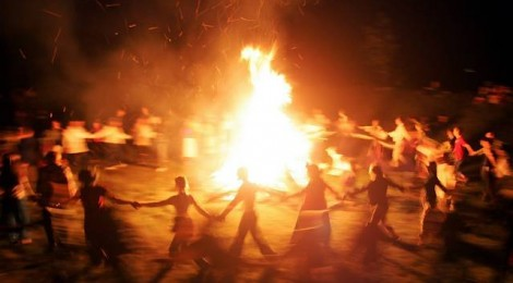 Belarusian neo-pagans dance around a bonfire celebrating the summer solstice in small town Rakov, some 45 kilometers (28 miles) northwest from Minsk, Saturday, June 23, 2007. The festivities of Ivan Kupala, or John the Baptist, is similar to MardiGras and reflects pre-Christian Slavic traditions and practices. (AP Photo/Sergei Grits)